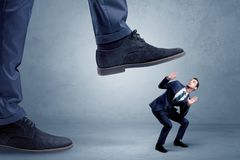 Trampled small businessman in suit royalty free stock images