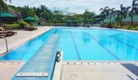 Trampolín por la piscina Imagen de archivo libre de regalías