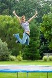 trampoline девушки стоковое фото