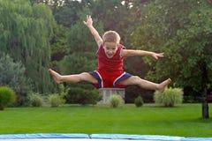 trampoline мальчика скача Стоковые Фотографии RF
