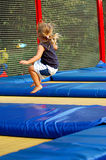 At trampoline. Blond girl having fun at trampoline Stock Photos