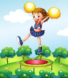 A trampoline below a young cheerdancer Stock Images