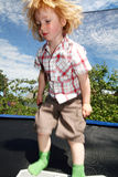 Trampoline child boy bouncing jumping stock photo