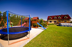 Trampoline in children's playground Royalty Free Stock Image