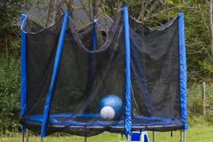 Trampoline. A fenced in trampoline for the kids stock photo