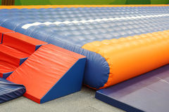 Trampoline. / Inflatable jumping place for kids stock photo