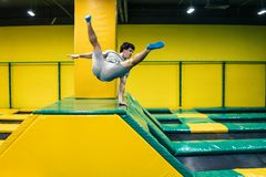 Trampoline jumper performs acrobatic exercises on the trampoline. Trampoline jumper performs complex acrobatic exercises and somersault on the trampoline stock photography