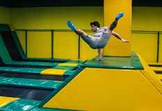 Trampoline jumper performs acrobatic exercises on the trampoline. Trampoline jumper performs complex acrobatic exercises and somersault on the trampoline stock images