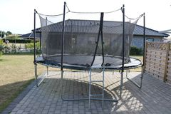 Trampoline. Jumping trampoline. Outdoor trampoline with safety net. Kids motion trampoline royalty free stock image