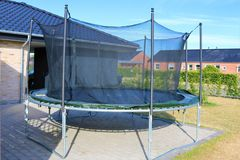 Trampoline. Jumping trampoline. Outdoor trampoline with safety net. Kids motion trampoline royalty free stock photo