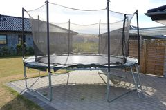 Trampoline. Jumping trampoline. Outdoor trampoline with safety net. Kids motion trampoline stock images