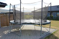 Trampoline. Jumping trampoline. Outdoor trampoline with safety net. Kids motion trampoline royalty free stock images