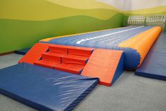 Trampoline. / Inflatable jumping place for kids royalty free stock photo