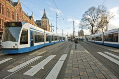 Trams at the central station in Amsterdam the Neth. Erlands Stock Photography
