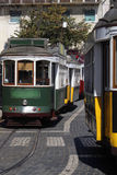 Trams crossing in a street. In Lisbon, Portugal Stock Photo