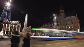 Trams drives by the City Hall on Dam Square at night. Time Lapse. AMSTERDAM, NETHERLANDS - JANUARY 05, 2017: Trams drives by the City Hall on Dam Square at stock video footage
