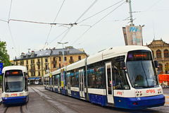 Trams in Geneva. Two trams moving on a Place de Neuve in Geneva.The Geneva tramway network is a network of tramways forming the core element of the public Royalty Free Stock Photography