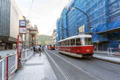 Trams on Narodni Street and people waiting for the passage of a. Prague, Czech Republic, May 28, 2017.- Trams on Narodni Street and people waiting for the Royalty Free Stock Photo