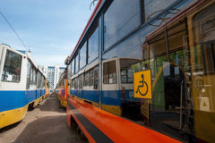 Trams are in a park, ready to travel the route disabled yellow sign at the wheel Stock Photography