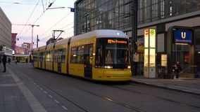 Evening video of trams and passengers at Alexanderplatz Station, Berlin, Germany. TRAMS AND PASSENGERS OUTSIDE ALEXANDERPLATZ TRAM AND TRAIN STATION, BERLIN stock footage