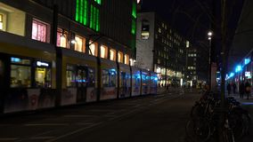 Trams and people by Alexanderplatz Station at night, Berlin, Germany stock footage