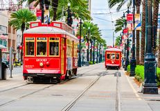 Trams pubic transport on Canal Street in New Orleans, Louisiana. New Orleans, Louisiana - February 6, 2017: Tram pubic transport on Canal street royalty free stock photo