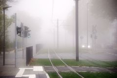 Trams and roads in the fog. Trams and infrastructure in a city in the fog Stock Photography