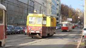 Trams run along the street. Empty trams are on the road to the depot in Kiev, Ukraine stock video