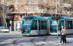Trams on street in Barcelona Stock Image