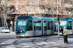 Trams on street in Barcelona Stock Photo