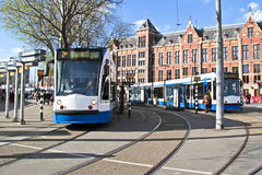 Trams waiting in Amsterdam Netherlands Royalty Free Stock Photos