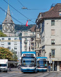 Trams in Zurich. Zurich, Switzerland - 21 August, 2015: two trams on the junction of the Bleicherweg street and the Paradeplatz square. Trams make an important Royalty Free Stock Image