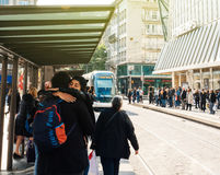 Tramway arriving in station in France with people rush hours com Royalty Free Stock Photo