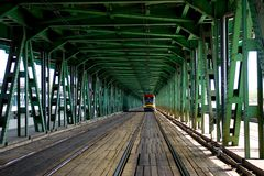 Tramway on a bridge. Tramway wagon running a bridge with view of a perspective stock photo