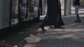 Tramway and bus station focused on pedestrians feet. stock video footage