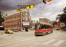 Tramway carriage, taxi and. 'Filmores' hotel on the city street on June 28, 2011 in Toronto, Canada Stock Photo