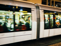 Tramway with Christmas decorations reflected at night Royalty Free Stock Photo