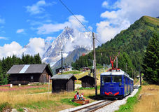 Tramway of Montblanc, France. SAINT GERVAIS, FRANCE - AUGUST 20: Old fashioned Montblanc tramway goes through the Chamonix valley on August 20, 2015. The Mont Royalty Free Stock Photography