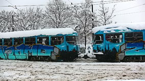 Tramway painted in color of football club Dinamo. ZAGREB, CROATIA - JANUARY 14: Heavy snowing at king Tomislav square and tramway painted in color of main stock video footage