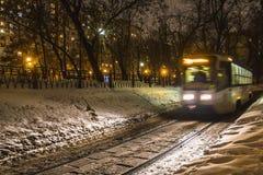 Tramway passing along urban park i Stock Photography