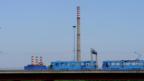 Tramway passing in front of the power plant stock footage
