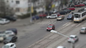 Tramway passing in ordinary traffic. Urban stock footage