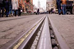 The tramway rails in the middle of the old cobblestone in the city stock photo