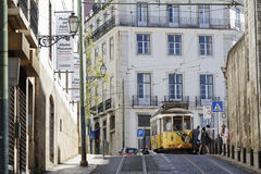 Tramway in the streets of Alfama. LISBON, Portugal, April 5, 2017 : Tramway in Lisbon city center. The tramway network serves the capital city of Portugal since Royalty Free Stock Image