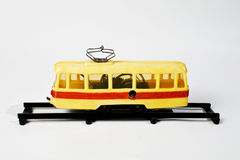 Tramway toy. Old yellow tramway toy siting on rail Royalty Free Stock Images