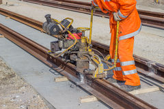 Tramway track construction worker with rail grinding machine 2 Royalty Free Stock Photo