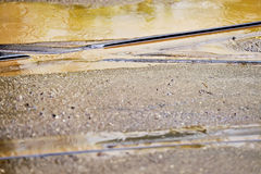 Tramway track during rainfall. Detail shot with tramway track during rainfall Stock Photo