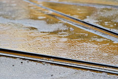 Tramway track during rainfall. Detail shot with tramway track during rainfall Royalty Free Stock Image
