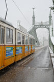 Tramway during winter in Budapest. Tramway on the Liberty bridge in Budapest during winter, Hungary Royalty Free Stock Photo