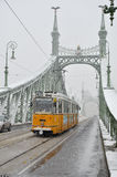 Tramway during winter in Budapest. Tramway on the Liberty bridge in Budapest during winter, Hungary Stock Images